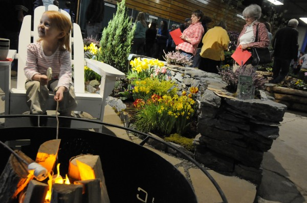 During her visit to the Bangor Garden Show on Sunday, four-year-old Natalie Francis of Bangor pretended to roast a marshmallow over a simulated fire nestled in a fire ring made by TPC-n-Smore, LLC of Brewer. The three-day show, which ended Sunday, featured eight gardenscapes by area designers as well as vendor booths and demonstrations.