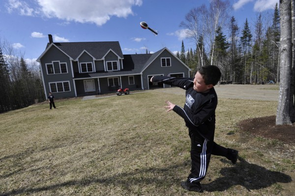 Jacob Austin (right), 9, of Ellsworth hurls a foam toy projectile to friend Kyle Kivler in the front yard of the Kivler family's new home in Hermon's newly developed Copper Ridge subdivision in Hermon.  Hermon is a growing bedroom community next to Bangor. Photographed Friday, April 22, 2011.