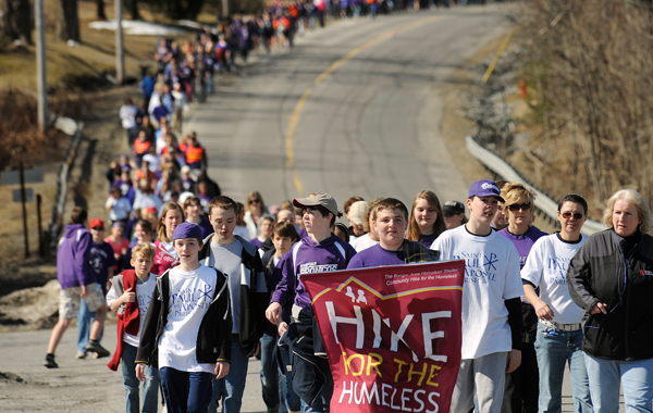 People walk along Rt-1 in Hampden during the annual Community Hike for the Homeless event.  About 2000 people participated in the fundraiser for the Bangor Area Homless Shelter and walked from four locations to the Bangor Waterfront Saturday.