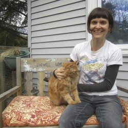 Holly Twining at home with her cat, Lulu.