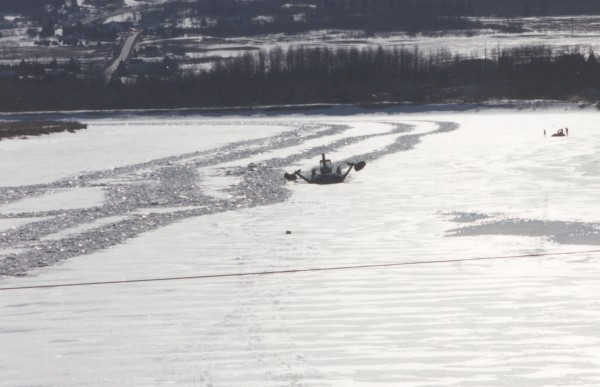 An ice breaker leaves a wake of crushed ice as it moves back and forth in the Aroostook River to prevent an ice jam in Fort Fairfield in 1995.