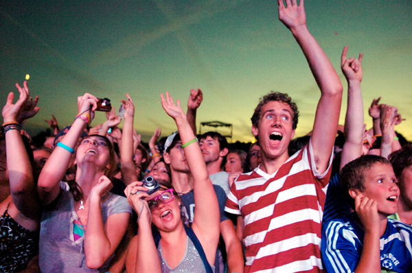 Attendees cheer as OK Go takes the stage at KahBang on the Bangor Waterfront in Aug. 2010. In the front row photographing and cheering (from left) are Katie Todd, 17, of Jonesport, Paiden Carver, 17, of Beals Island, Zach Smith, 17, of Jonesport and Iain Kurry, 13, of Falmouth.