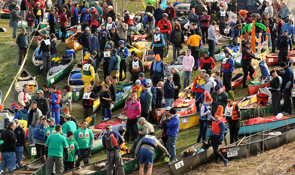 People gather on the bank of the Kenduskeag Stream before the 2011 16.5 mile Kenduskeag Stream Race Saturday.  This year 903 people in 480 boats registered to run the 45th annual race.