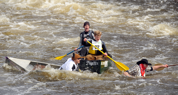 Two canoes collide below Six Mile Falls in Bangor during the 45th annual Kenduskeag Stream Race Saturday.
