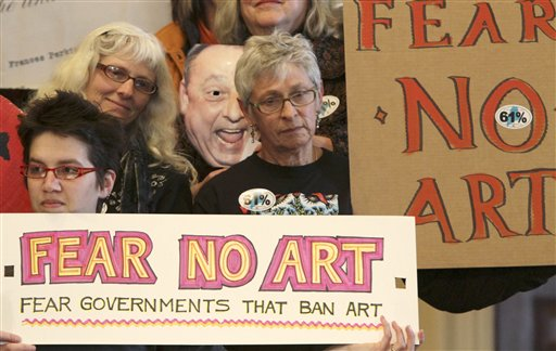 Protesters rally at the State House in Augusta, Maine demanding the return of the labor mural that Maine Gov. Paul LePage ordered removed from the Labor Department headquarters, on Monday, April  4, 2011. (AP Photo/Pat Wellenbach)