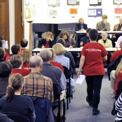 At the Bangor Public Library open forum Monday evening, the predominant color was red in support of the EMMC nurses who voted for a strike in response to an impass in labor negotiations.