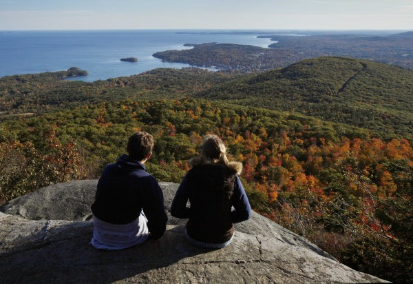 "A couple takes in the view from the ocean lookout ledges on 1375-foot Mount Megunticook at Camden Hills State Park in Camden in October 2009. Rescue crews carry down a man from Mt. Megunticook on Thursday, April 7, 2011. Police identified the man as Charles ""Reed"" Black, 68, of Camden. Earlier in the day, an injured woman, Black's wife, Lisa, 52, made her way down the mountain, which lead law enforcement authorities to search for her husband. Officials have not immediately disclosed if a crime occurred."