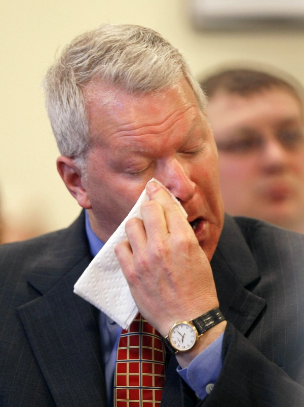 Paul Violette, former executive director of the Maine Turnpike Authority, wipes his face after appearing before the Legislature's Government Oversight Committee, Friday, April 15, 2011, in Augusta. Violette invoked his constitutional right against self-incrimination and refused to answer  questions about the authority's spending practices.