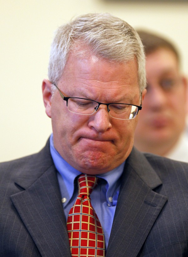 Paul Violette, former executive director of the Maine Turnpike Authority, grimaces before appearing before the Legislature's Government Oversight Committee, Friday, April 15, 2011, in Augusta. Violette invoked his constitutional right against self-incrimination and refused to answer  questions about the authority's spending practices.