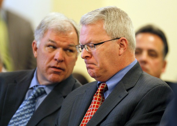 Paul Violette (right) former executive director of the Maine Turnpike Authority, grimaces after appearing before the Legislature's Government Oversight Committee, Friday, April 15, 2011, in Augusta, Maine. Violette invoked his constitutional right against self-incrimination and refused to answer  questions about the authority's spending practices.