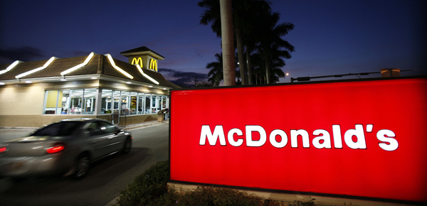 McDonald's Corp. plans to hold its first national hiring day Tuesday to fill 50,000 openings nationwide, seeking to lure new employees in a tough job market.