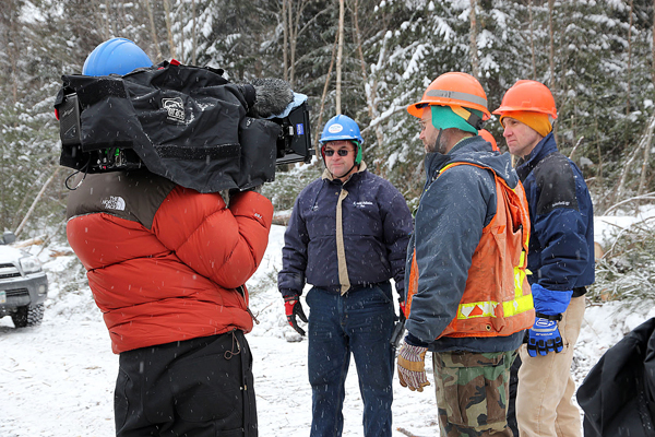 Eldon Pelletier (from left), Jim O'??Malley of Huber Resources and Bill Patterson of The Nature Conservancy film a segment for American Loggers.