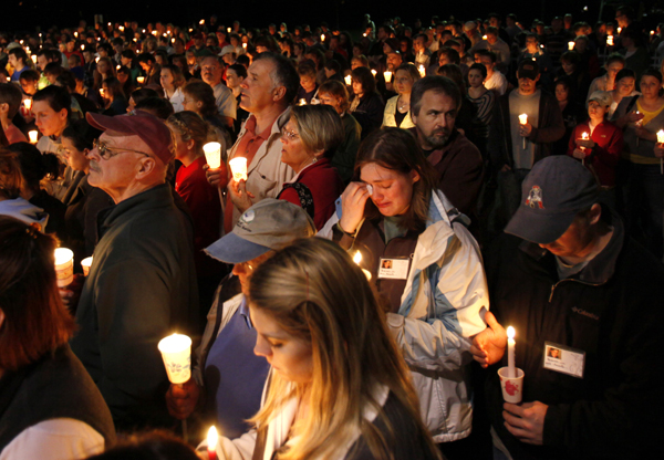 Mourners attend a candlelight memorial for Krista Dittmeyer of Portland on Thursday in Bridgton.