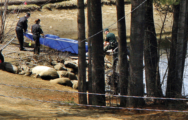 Police remove a blue tarp from the edge of a snowmaking pond at Mount Cranmore in North Conway, N.H. on Wednesday. The body of 20-year-old Krista Dittmeyer, of Portland, was found by divers in a retaining pond about a quarter-mile from where her car was found idling Saturday in the parking lot of Cranmore Mountain ski area in Conway, a town of 10,000 people.
