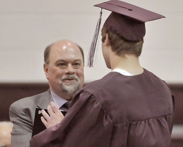 MVYDC Superintendant Eric Hansen hands out diplomas to graduates at the commencement ceremony held in Charleston, Friday April 29, 2011.