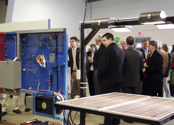 Visitors to the new Northern Maine Center for Excellence in Alternative Energy Training and Education look at equipment in the facility during a tour on Thursday April 21.2011. The facility, located a short distance from the Northern Maine Community College campus in the Skyway Industrial Park in Presque Isle, features both classroom and laboratory space for students in the building technology programs at the college.
