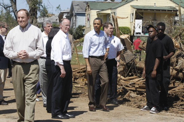President Barack Obama, accompanied by Sen. Richard Shelby, R-Ala. (left) and Alabama Gov. Robert Bentley (center), tours tornado in Tuscaloosa, Ala., Friday, April 29, 2011.