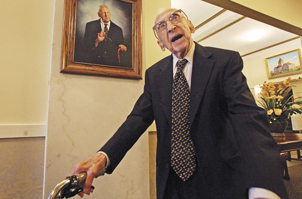 114 year old Walter Breuning  stands under a portrait of himself in the lobby of his senior residence in Great Falls, Mont, in  Oct. 2010.   Walter Breuning was 114, making him the oldest man and the second-oldest person in the world.  Breuning was born on Sept. 21, 1896, in Melrose, Minn., and moved to Montana in 1918.   Breuning lived at the Rainbow Senior Living retirement home in Great Falls.   Retirement home spokeswoman Stacia Kirby confirmed that Breuning died Thursday, April 14, 2011 of natural causes in a Great Falls hospital.
