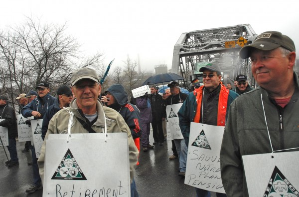 Retirees of the former Fraser Paper Co. and their supporters on Thursday morning blocked international traffic between Madawaska, Maine, and Edmundston, New Brunswick. Positioned on the Canadian side of the border, the retirees demonstrated to draw attention to double-digit cuts to pension funds in the wake of Fraser's sale to, and subsequent financial restructuring by Twin Rivers Paper Co., which currently operates mills in Edmundston and Madawaska. Since 2009 the former mill workers say their pensions have been reduced by 35 percent.