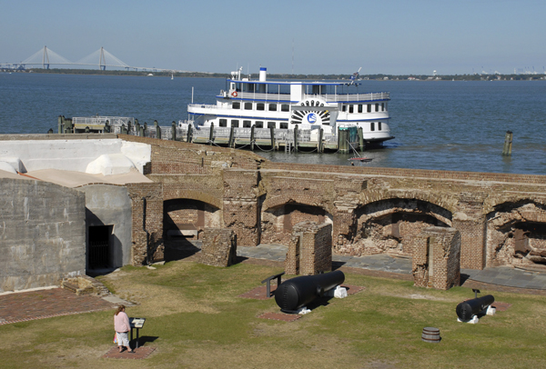 Transport to Fort Sumter by the tour boat moored at the fort's pier, a tourist reads an information plaque set up on the parade grounds. Fort Sumter rose three stories high when Confederate soldiers opened fire on April 12, 1861. Warfare reduced the fort to ruins by 1865.