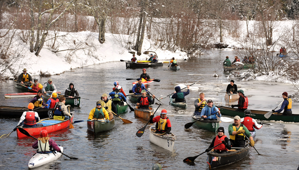 Participants of the 2011 Passagassawakeag River canoe race wait for their starting time Saturday in Waldo.  In spite of Friday's snowstorm 93 boats registered for the race.  This year the competitors not only had to contend with the usual rapids, cold water and rocks but floating chunks of icy snow were also among the obstacles.