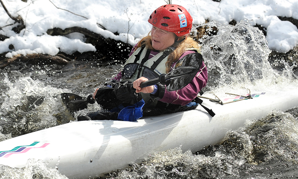 Leslie Gregory negotiates the rapids near the Poors Mill Road during the Passagassawakeag River canoe race in Belfast Saturday.