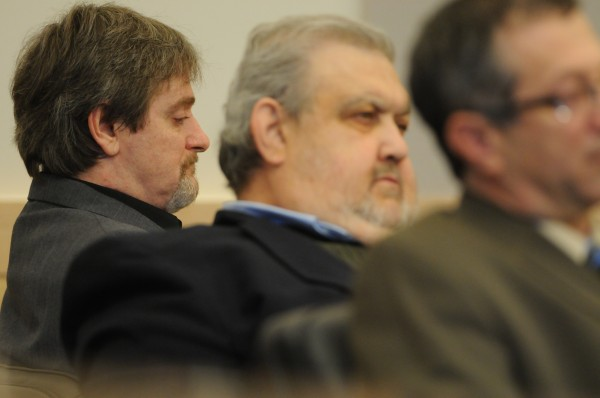 Perley Goodrich Jr., left, and his attorneys Julio DeSanctis, center, and Jeffrey Silverstein, right, listen as Assistant Attorney General Andrew Benson presents his closing arguments in the Perley Goodrich Jr. murder trial at the Penobscot Judicial Center in Bangor on Tuesday, April 5, 2011.