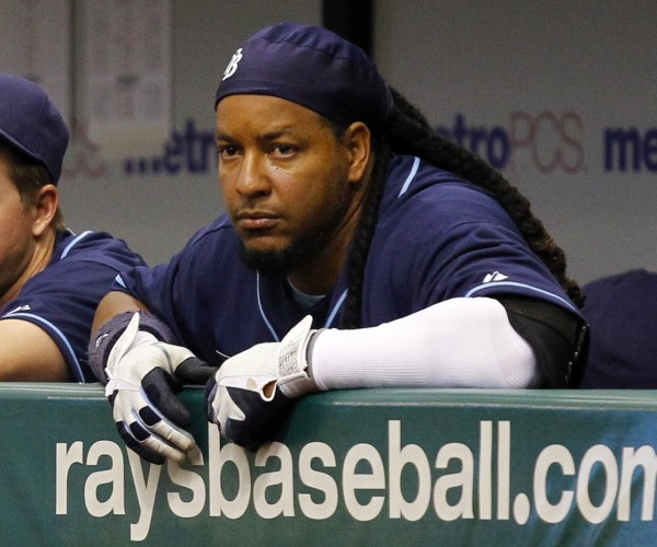 Tampa Bay Rays' Manny Ramirez watches from the dugout during a baseball game April 6 against the Los Angeles Angels in St. Petersburg, Fla. Ramirez has notified Major League Baseball that he is retiring after being notified of an issue under MLB's drug policy.  The commissioner's office issued a statement Friday, April 8, 2011, that said Ramirez decided to retire rather than go through MLB's Joint Drug Prevention and Treatment Program.