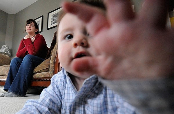 Julie Robbins watches her 9-month-old son, Daniel, as he crawls around her living room in Bangor. Robbins, who has three healthy children — two of which are teenagers — recently received education regarding Shaken Baby Syndrome