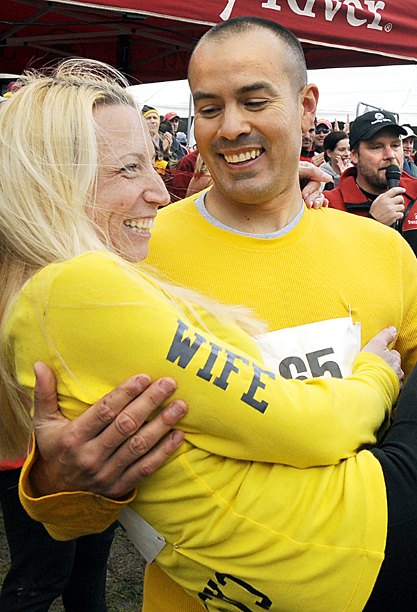 Dave and Lacey Castro, formerly of Lewiston celebrate after winning the North American Wife Carrying Championship at Sunday River in 2009. The couple, who now live in Alfred, are hoping to travel to Finland for the World Championship in 2011.