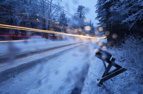 A snowplow clearing the road in Freeport during a spring snowstorm leaves a light trail in this 15-second time-exposure during Friday's snowstorm.