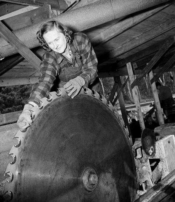 In Nov. 10, 1942,  Laura Willey, a boss lumberjack overseeing the crew at the sawmill at Turkey Pond in Concord, N.H., handles a saw blade at the mill operated entirely by women under the tutelage of the Northeastern Timber Salvage Administration. A University of New Hampshire forestry specialist has written a book about their experience called &quotThey Sawed Up a Storm.&quot