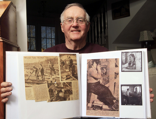David Story holds a scrapbook with photos from  Concord, N.H., in1942 at his home Friday, April 8, 2011 in Hopkinton, N.H. With World War II under way and sawmill labor scarce, the U.S. Forest Service recruited a dozen women to mill the logs into lumber for the war effort. A University of New Hampshire forestry specialist has written a book about their experience called &quotThey Sawed Up a Storm.&quot