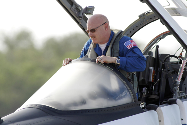 Space shuttle Endeavour Commander Mark Kelly exits his T-38 jet after arriving at Kennedy Space Center in Cape Canaveral, Fla. Kelly is the husband of Congresswoman Gabrielle Giffords and will be on the STS-134 mission.