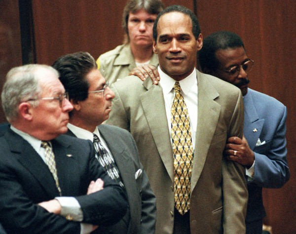 Attorney Johnnie Cochran Jr. holds onto O.J. Simpson as the not guilty verdict is read in a Los Angeles courtroom in this Tuesday morning, Oct. 3, 1995 file photo. Left is F. Lee Bailey and second from left is Robert Kardashian. Bailey will speak at 1 p.m. Friday, April 29, at the Gracie Theatre at Husson University.
