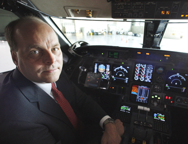Federal Aviation Administration (FAA) Chief Operating Officer Hank Krakowski poses in the cockpit of an FAA jet in a hangar at Washington's Reagan National Airport in 2008. Krakowski, the official who oversees the nation's air traffic system resigned Thursday and the FAA began a &quottop to bottom&quot review of the entire system following disclosures of four instances of air traffic controllers sleeping on the job.