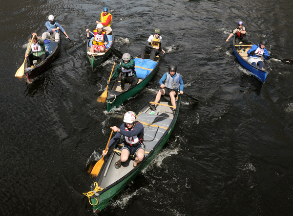 Canoes cross the starting line of the 36th annual Souadabscook Stream Race near the Bog Road bridge in Hampden Saturday.