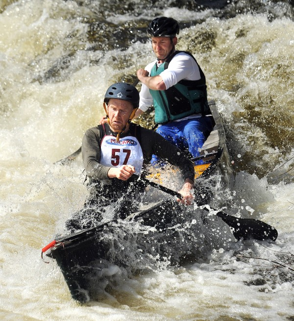 Jeff Owen (foreground) and Steve Woodard negotiate the drop at the Emerson Mill Road bridge during the 36th annual Souadabscook Stream Race in Hampden Saturday. They finished first in the race that had 44 boats registered to paricipate.
