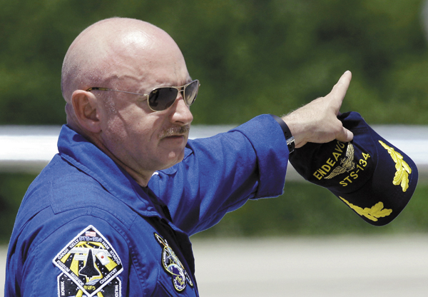STS-134 commander Mark Kelly points after arriving with fellow crew members at Kennedy Space Center in Cape Canaveral, Fla., Tuesday.  Kelly is the husband of wounded Arizona congresswoman Gabrielle Giffords. The space shuttle Endeavour and her crew of six, is scheduled to lift off Friday afternoon on an 14-day mission to the international space station.