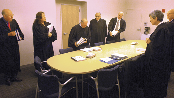 Maine Supreme Judicial Court justices gather in the jury room for a final discussion before entering the courtroom at the Penobscot Judicial Center in Bangor in Nov. 2010. From left are Justice Donald G. Alexander, Chief Justice Leigh I. Saufley, Justice Warren M. Silver, Justice Joseph M. Jabnar, Justice Andrew M. Mead, Justice Ellen A. Gorman and Justice Jon D. Levy.