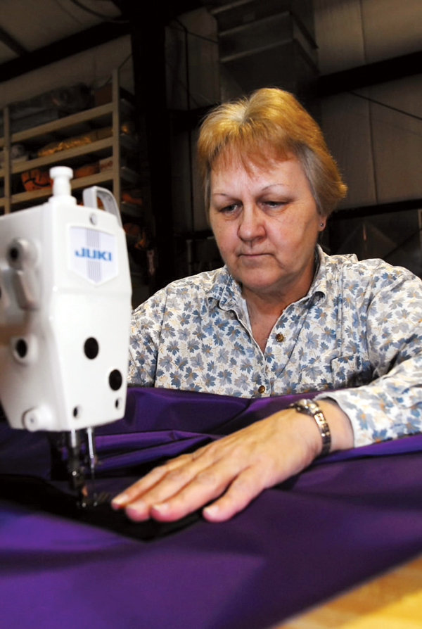 Gloria Phillips of Saco sews a bag that will be used to hold one of Transformit's fabric sculptures on Thursday.