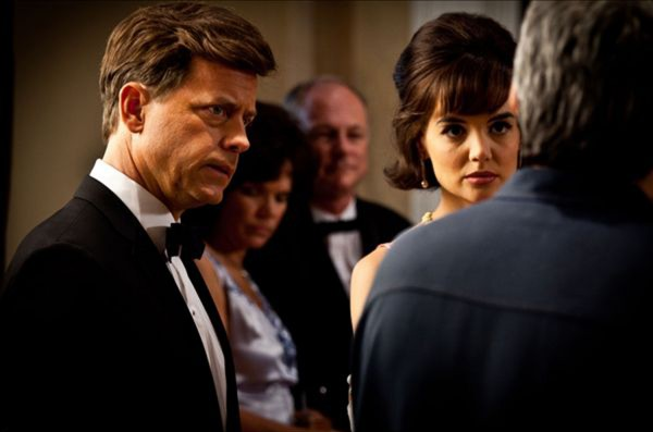 In this publicity image released by REELZCHANNEL, Greg Kinnear portrays Jack Kennedy (left) and Katie Holmes portrays Jacqueline Kennedy in a scene from the eight-part movie, &quotThe Kennedys,&quot premiering Sunday, April 3, 2011 on the REELZCHANNEL network.