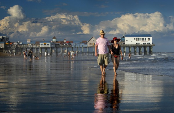 Dan Horner (left) and Cynthia Belaskie of Toronto stroll along the ocean in Old Orchard Beach last week. The popular tourist haven has rebounded from a dismal 2009 with help from weeks on end of ideal weather.