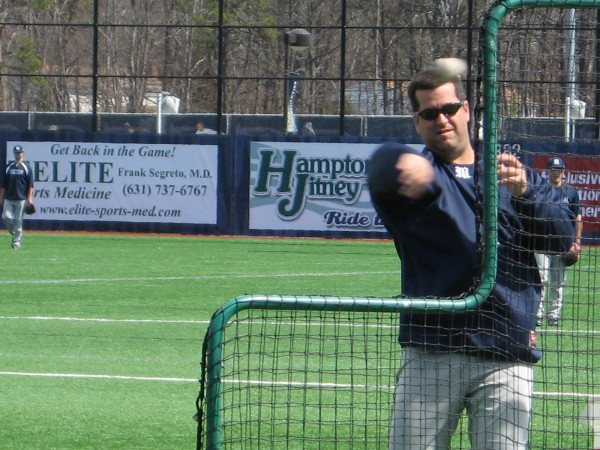 University of Maine assistant coach Jason Spaulding throws batting practice prior to Saturday's America East baseball doubleheader against Stony Brook in Oakdale, N.Y.