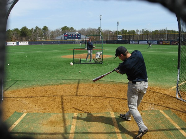 Freshman Alex Calbick of the University of Maine baseball team works on hitting the ball the opposite way Saturday as the Black Bears prepared for their doubleheader against Stony Brook.