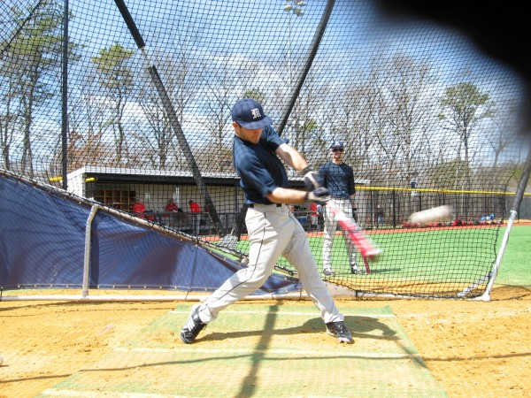 Eric White of Brewer, a freshman on the UMaine baseball team, connects during batting practice prior to Saturday's doubleheader against Stony Brook in Oakdale, N.Y.