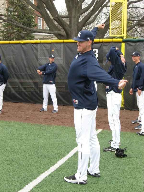 Pitcher Shaun Coughlin of the University of Maine does stretching exercises before Sunday's America East baseball doubleheader against Stony Brook at Garden City, N.Y.
