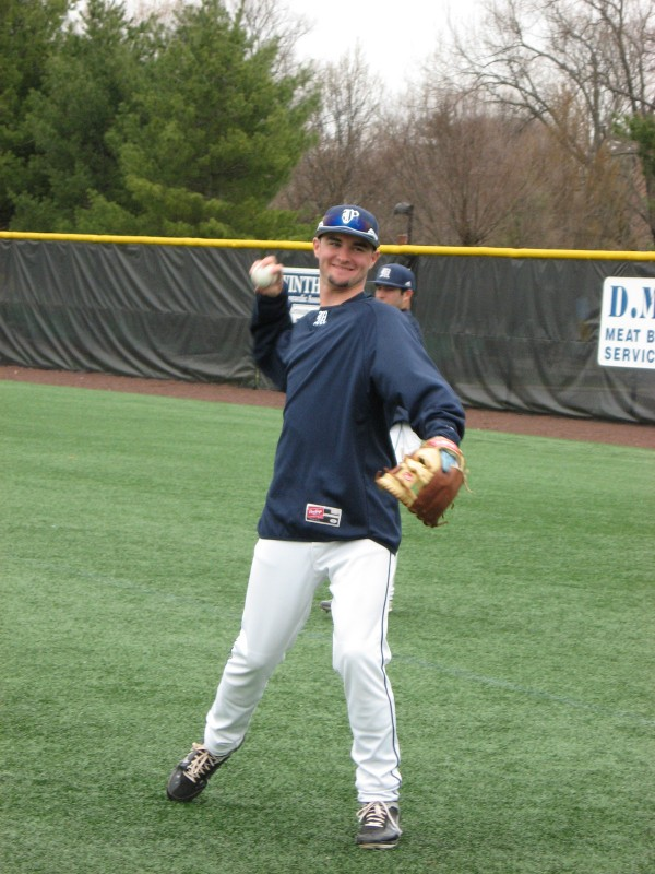 Freshman infielder Mike Connolly plays catch with a University of Maine teammate before Sunday's America East baseball doubleheader against Stony Brook.