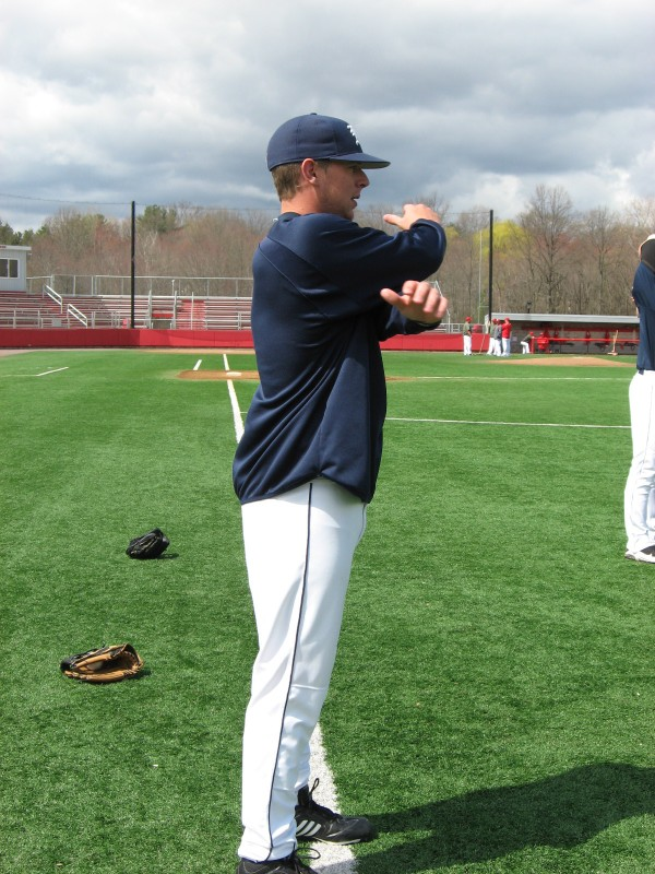 Junior righthander A.J. Bazdanes of the University of Maine goes through his stretching regimen Sunday prior to his start against Hartford. The Hawks beat the Black Bears 4-1.