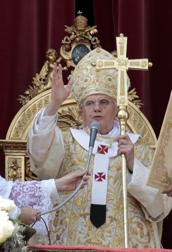 Pope Benedict XVI delivers his blessing during the &quotUrbi et Orbi&quot (Latin for to the City and to the World) message from the balcony of St. Peter's Basilica, at the end of the Easter Mass in St. Peter's Square, at the Vatican, Sunday, April 24, 2011. Benedict XVI urged an end to fighting in Libya, using his Easter Sunday message to call for diplomacy and peace in the Middle East.